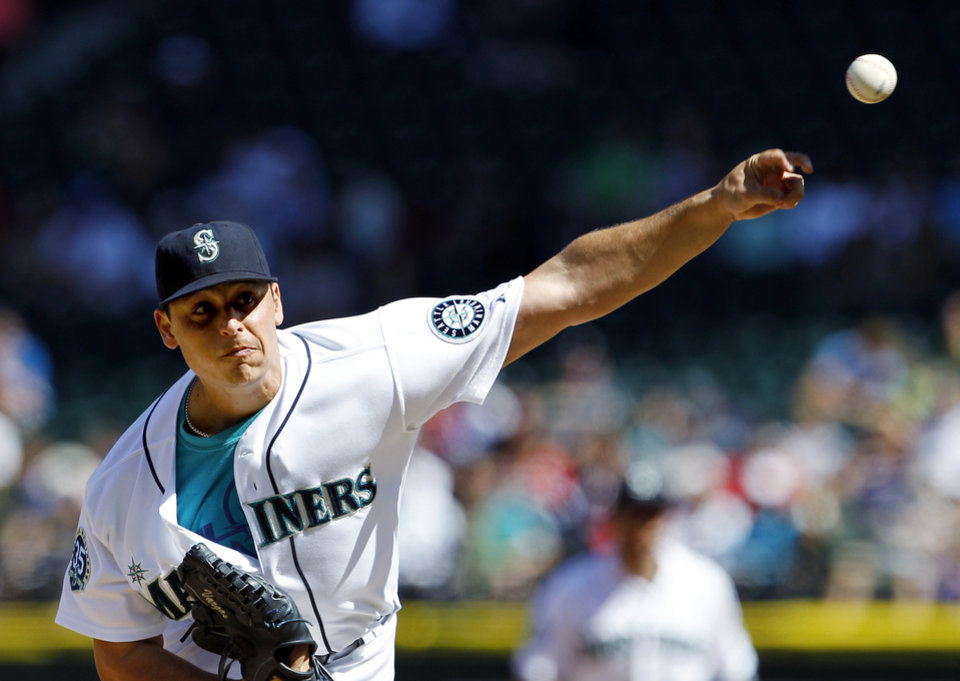 Photo -   Seattle Mariners starting pitcher Jason Vargas throws against the Boston Red Sox in the second inning of a baseball game, Monday, Sept. 3, 2012, in Seattle. (AP Photo/Elaine Thompson)