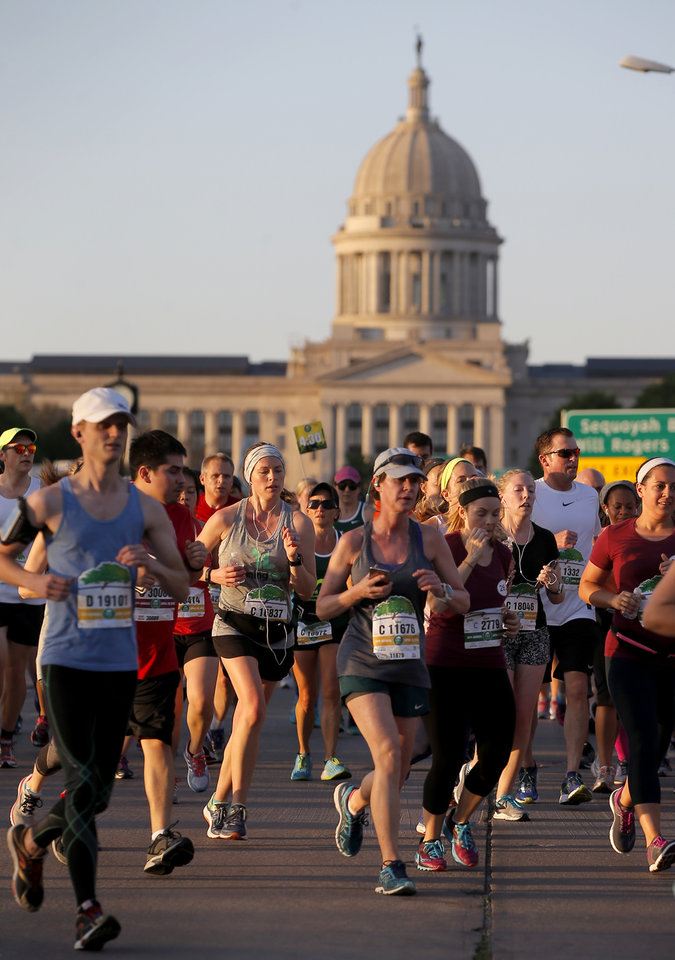 Photo - Runners pass south of state Capitol on Lincoln Blvd. during the Oklahoma City Memorial Marathon in Oklahoma City, Sunday, April 29, 2018. Photo by Bryan Terry, The Oklahoman