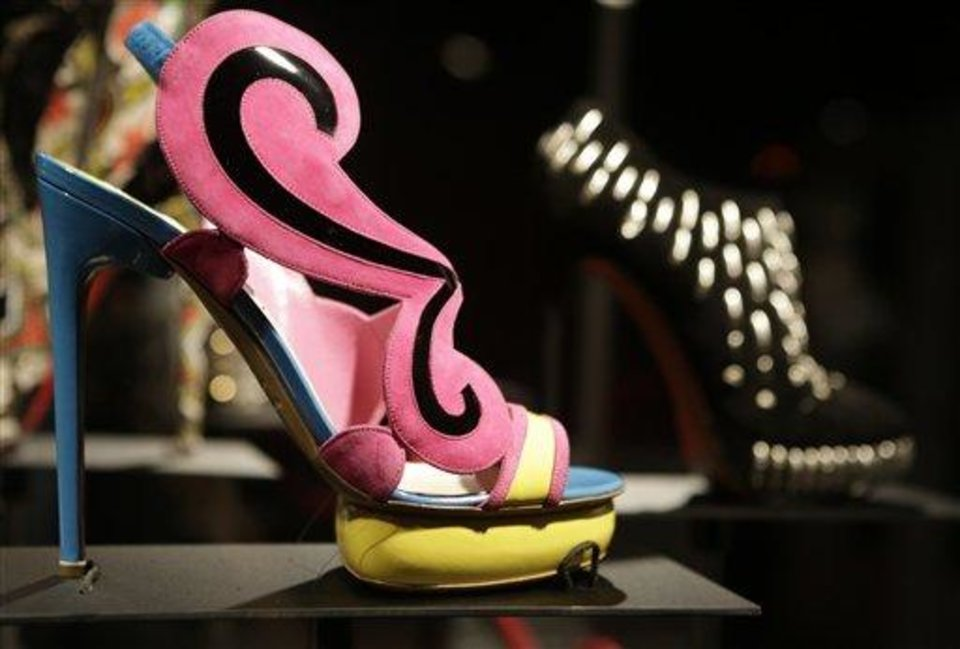 "This Feb. 11, 2013 photo shows a colorful mod shoe ""Cruise"" by Nicholas Kirkwood is displayed at the ""Shoe Obsession"" exhibit at The Museum at the Fashion Institute of Technology Museum in New York. The exhibition, showing off 153 specimens, runs through April 13. (AP Photo/Kathy Willens)"