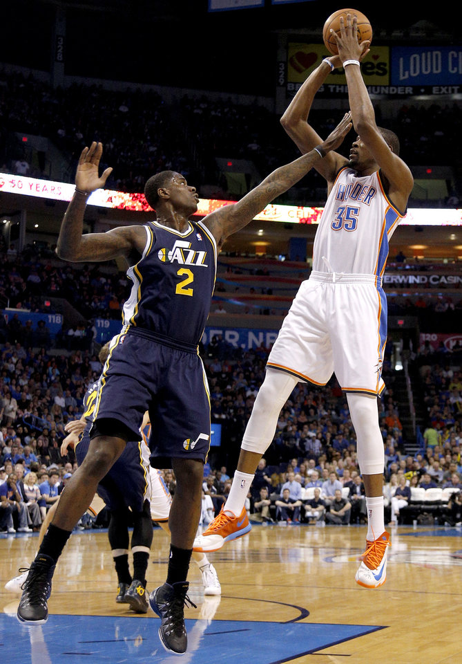Photo - Oklahoma City 's Kevin Durant (35) shoots as Utah's Marvin Williams (2) defends during the NBA game between the Oklahoma City Thunder and the Utah Jazz at the Chesapeake Energy Arena, Sunday, March 30, 2014, in Oklahoma City. Photo by Sarah Phipps, The Oklahoman