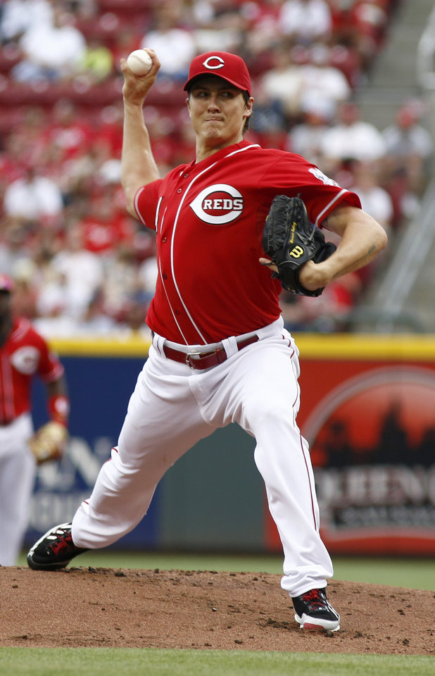 Photo - Cincinnati Reds starting pitcher Homer Bailey throws against the Philadelphia Phillies during the first inning of a baseball game, Sunday, June 8, 2014, in Cincinnati. (AP Photo/David Kohl)