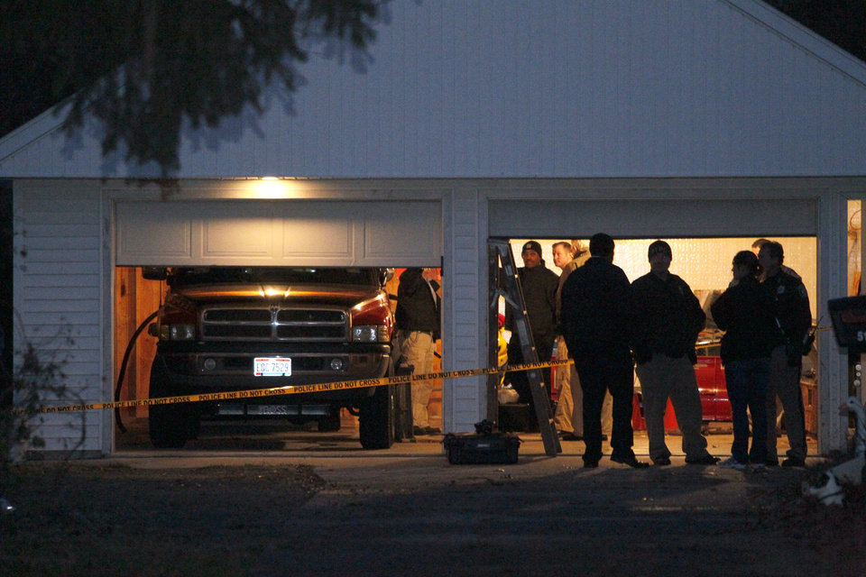 Authorities respond to a report of carbon monoxide poisoning on Harvest Lane in Toledo, Ohio, on Monday, Nov. 12, 2012. The bodies of three children and two adults were found inside the garage Monday, and authorities said they believe the deaths — apparently from carbon monoxide poisoning — weren't accidental. (AP Photo/The Blade, Amy E. Voigt) MANDATORY CREDIT; MAGS OUT; TV OUT; SENTINEL-TRIBUNE OUT; MONROE EVENING NEWS OUT; TOLEDO FREE PRESS OUT