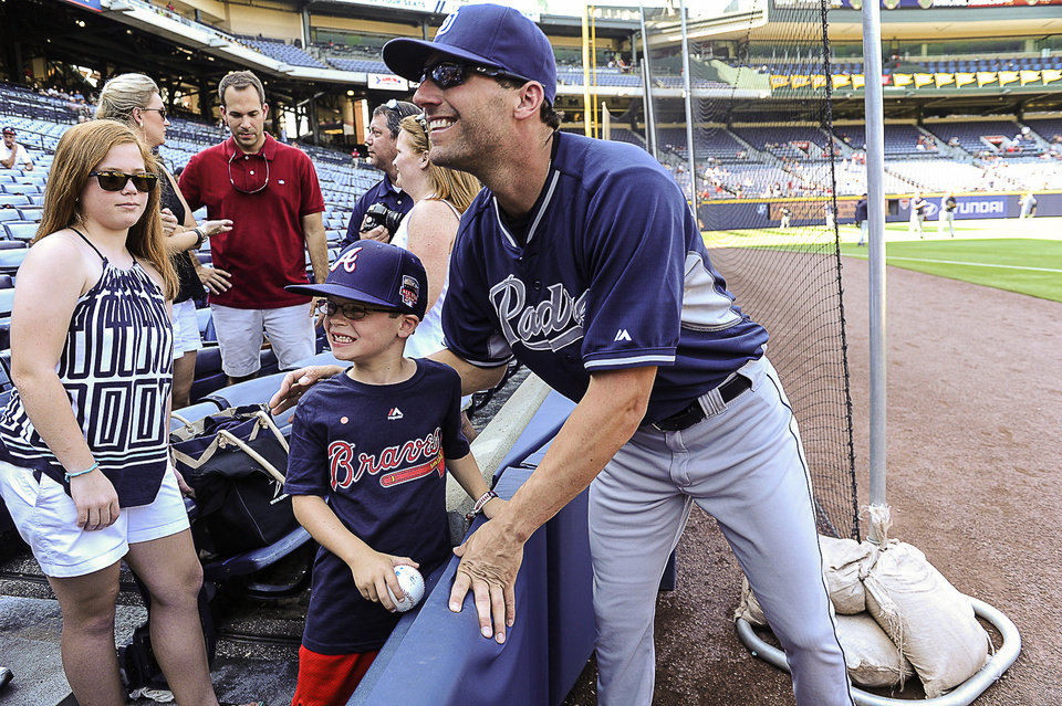 Photo - San Diego Padres' Jeff Francoeur poses with Parker Davis, 7, of Advance, N.C., before the Padres' baseball game against the Atlanta Braves, Saturday, July 26, 2014, in Atlanta. Francoeur is a former Braves player. (AP Photo/John Amis)