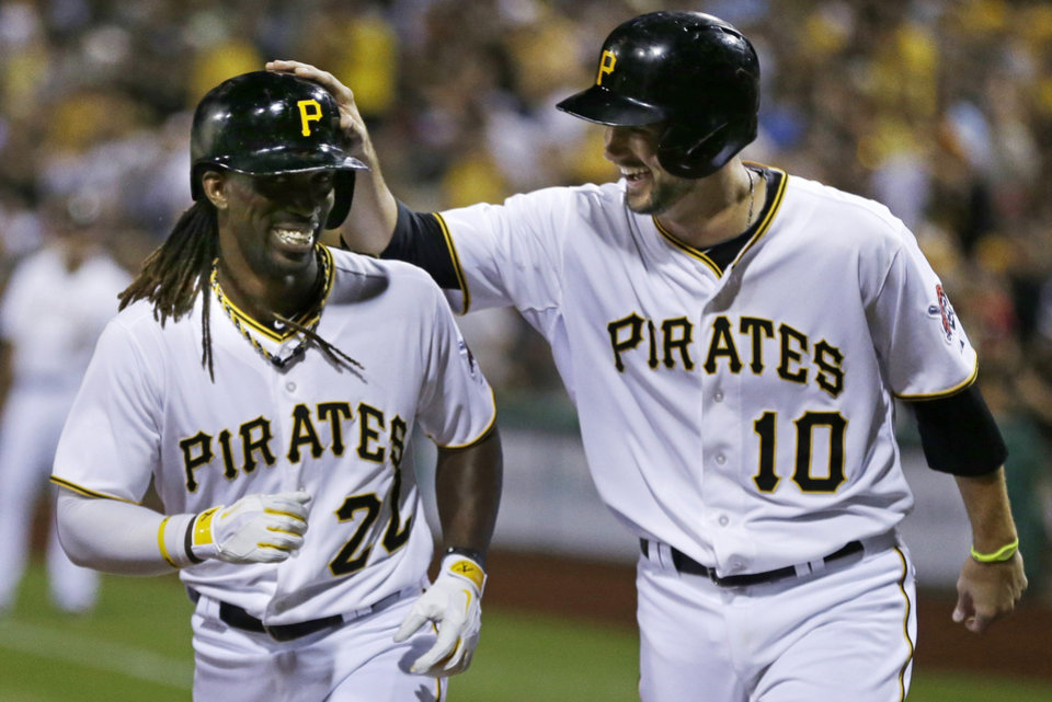 Photo - ADVANCE FOR WEEKEND EDITIONS, AUG. 31 - SEPT. 1 - FILE - In this July 30, 2013 file photo, Pittsburgh Pirates' Andrew McCutchen (22) celebrates with teammate Jordy Mercer (10) after hitting a two-run home run off St. Louis Cardinals starting pitcher Tyler Lyons during the fifth inning of the second baseball game of a doubleheader in Pittsburgh. The Pirates run of 20 consecutive losing seasons is the longest in North American professional sports history, but the end is just a formality, and these resurgent Pirates are now focused on a postseason berth and beyond. (AP Photo/Gene J. Puskar, File) ORG XMIT: NY196