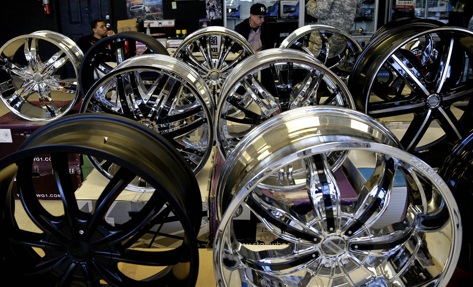 Photo - In this Monday, March 4, 2013 photo taken in Fayetteville, N.C., car and truck wheels appear on display in the showroom of Auto Express located near the entrance to Fort Bragg. More than 8,500 civilian employees on the base will be furloughed one day a week starting in late April, the equivalent of a 20-percent pay cut, possibly affecting small businesses near the base.  (AP Photo/Gerry Broome)