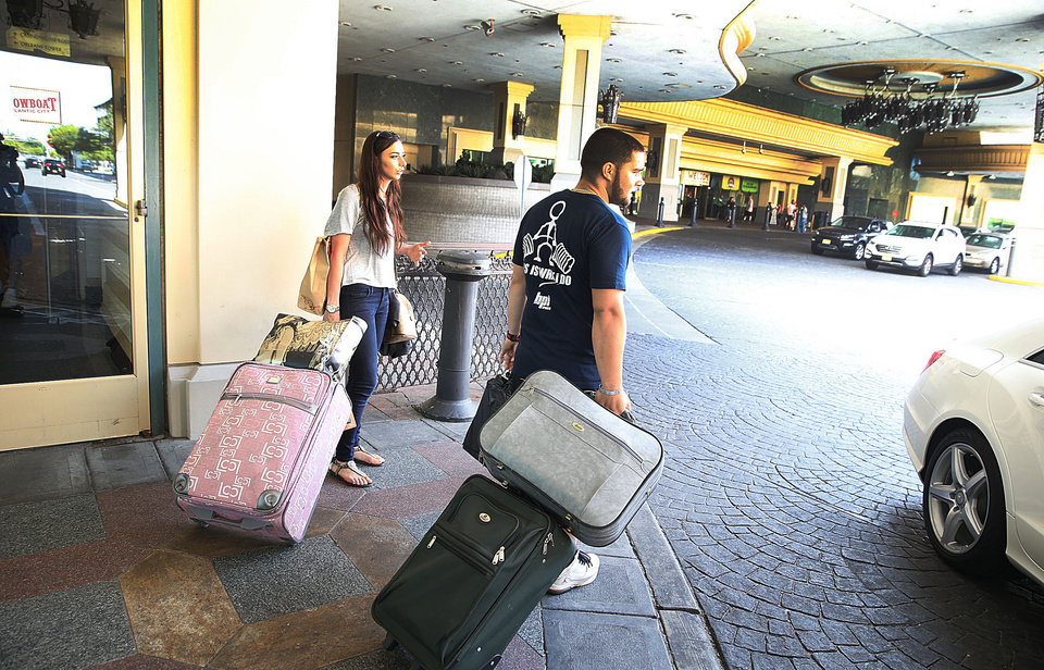 Photo - Leann Toscani and Joe Russo of Newburgh N.Y., leave after their last stay at the Showboat Casino before it's closing. Sunday, Aug. 31 2014.  (AP Photo/The Press of Atlantic City, Ben Fogletto)