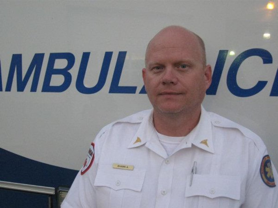 Shawn Altebaumer, an EMSA paramedic who came upon a group of motorists grabbing money from a bank bag dropped on Interstate 40 near Meridian Avenue Monday afternoon. <strong></strong>