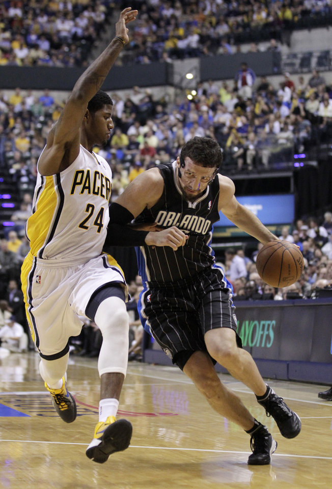 Orlando Magic forward Hedo Turkoglu, right, drives on Indiana Pacers guard Paul George in the first half of Game 5 of an NBA basketball first-round playoff series, in Indianapolis on Tuesday, May 8, 2012. (AP Photo/Michael Conroy)