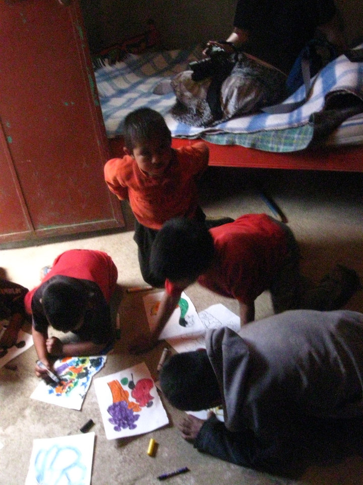 Several Guatemalan boys, enamored with coloring books given to them by missionaries, spend time with their newfound hobby. Photo provided <strong></strong>