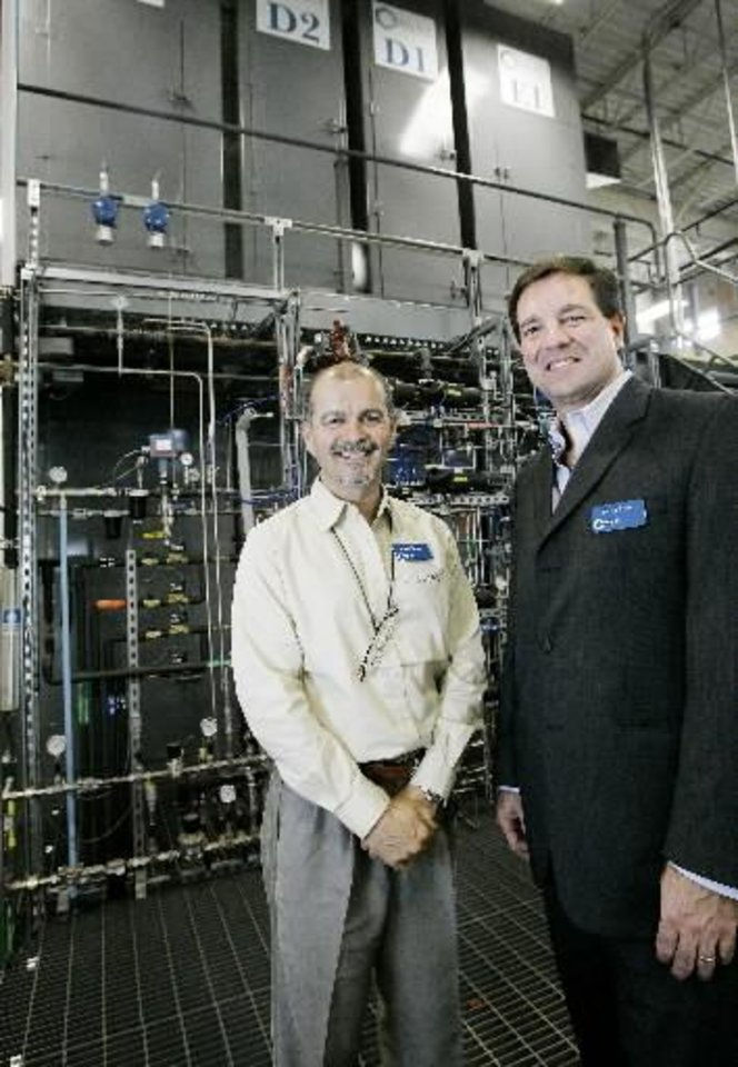 Daniel Resasco, founder and chief scientist and David Arthur, CEO, next to a manfacturing platform for Nano Tubes at the  Southwest Nano Technologies facility in Norman, OK. Thursday, Sept. 25, 2008. BY JACONNA AGUIRRE