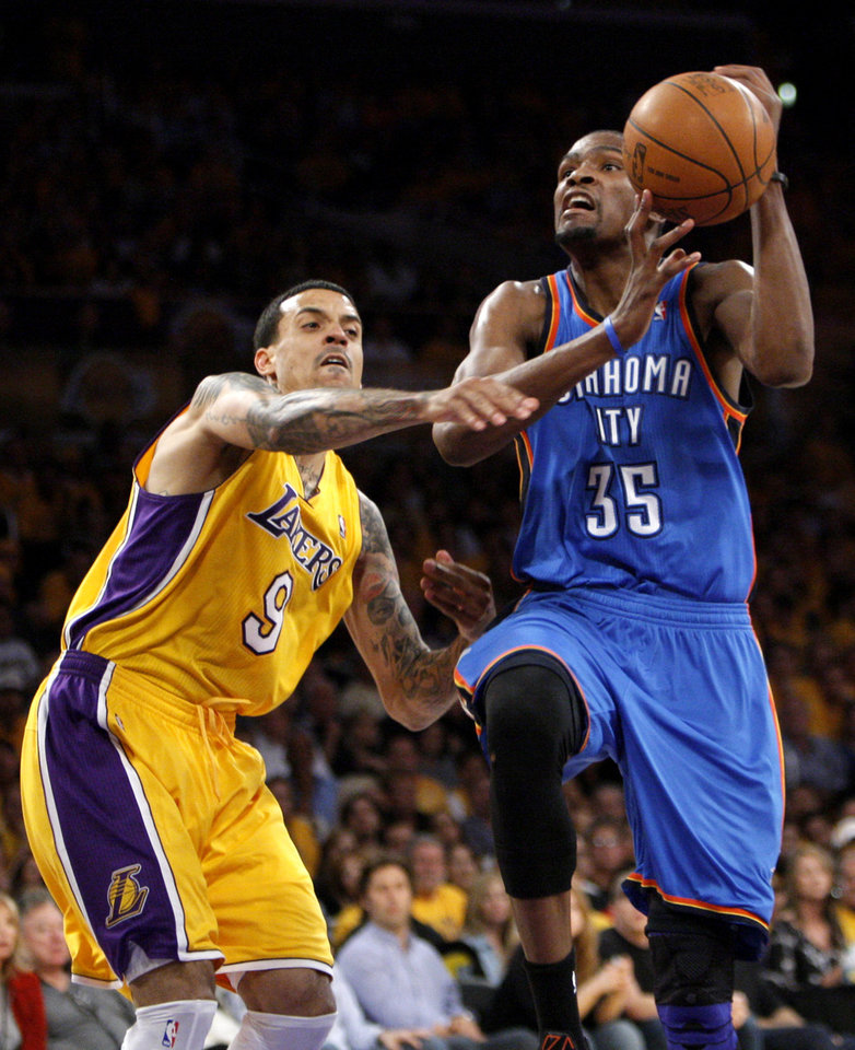 Oklahoma City's Kevin Durant (35) drives to the basket as Los Angeles' Matt Barnes (9) defends during Game 3 in the second round of the NBA basketball playoffs between the L.A. Lakers and the Oklahoma City Thunder at the Staples Center in Los Angeles, Friday, May 18, 2012. Photo by Nate Billings, The Oklahoman