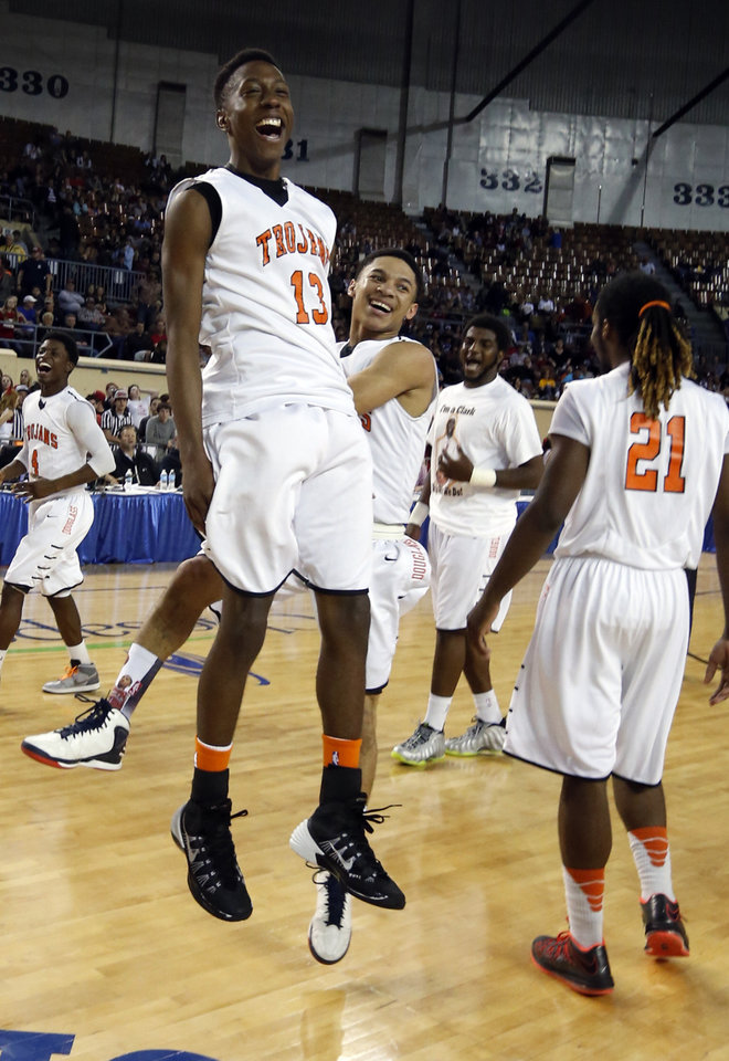 Photo - Douglass' Marcus Fite leaps foer joy as they defeat Stilwell Indians 78-50 in the finals of the State Class 4A Boys Basketball Tournament at the Fairgrounds Arena on Saturday, March 15, 2014, in Oklahoma City, Okla. Photo by Steve Sisney, The Oklahoman