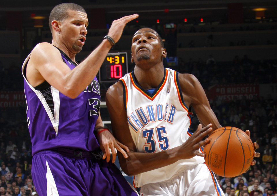 Photo - Oklahoma City's Kevin Durant drives past Sacramento's Francisco Garcia during the NBA basketball game between the Oklahoma City Thunder and the Sacramento Kings at the Ford Center in Oklahoma City, Tuesday, March 2, 2010.  Photo by Bryan Terry, The Oklahoman