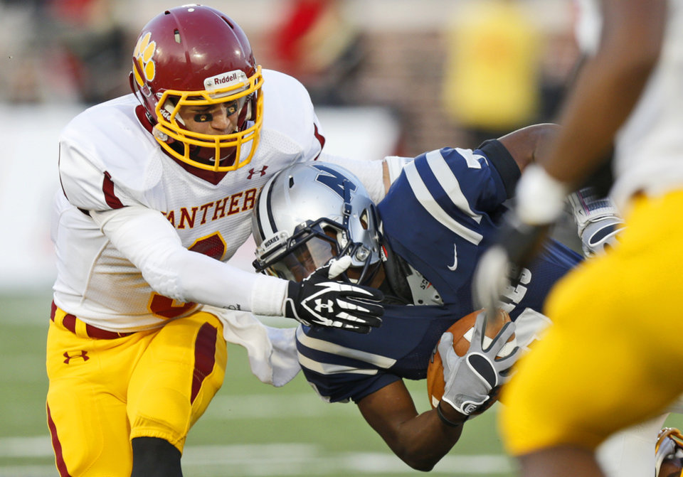 Putnam City North\'s Alex Clark brings down Marque Depp of Edmond North during a high school football game at Wantland Stadium in Edmond, Okla., Friday, September 21, 2012. Photo by Bryan Terry, The Oklahoman