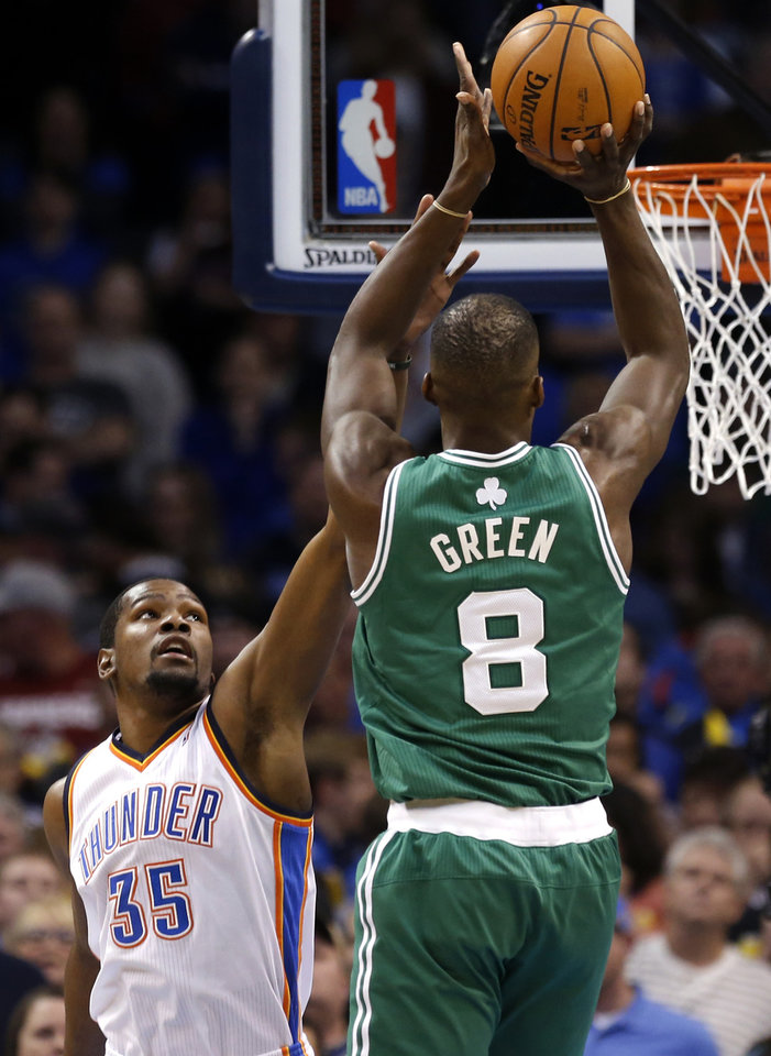 Photo - Boston's Jeff Green (8) shoots as Oklahoma City's Kevin Durant (35) defends during the NBA game between the Oklahoma City Thunder and the Boston Celtics at the Chesapeake Energy Arena., Sunday, Jan. 5, 2014. Photo by Sarah Phipps, The Oklahoman
