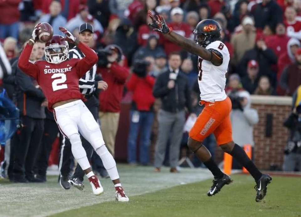 Photo -  Oklahoma wide receiver CeeDee Lamb has made lots of big catches this season, but Oklahoma State cornerback Rodarius Williams and the rest of the Cowboy defense hopes to make life tougher Saturday for everyone on the Sooner offense. [SARAH PHIPPS/THE OKLAHOMAN]