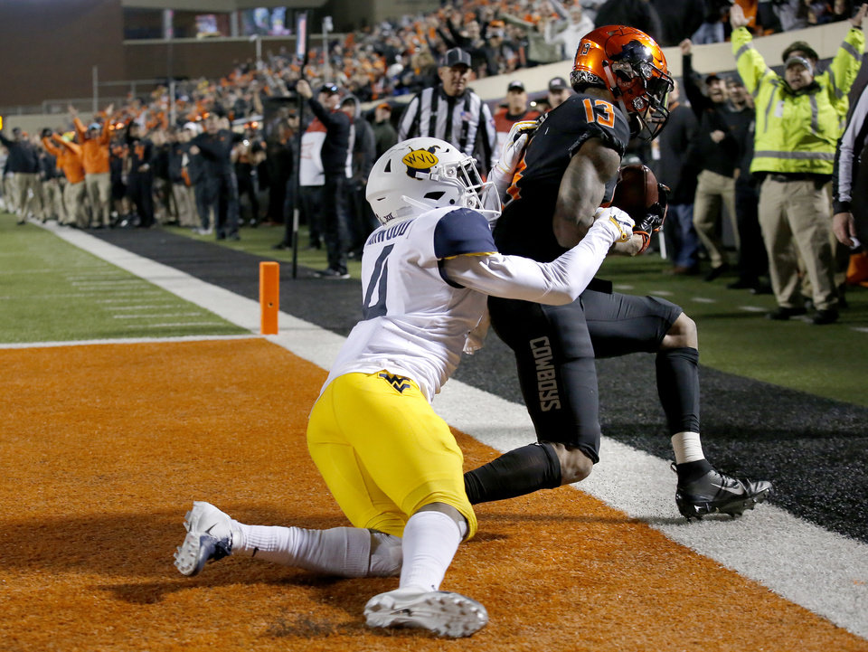 Photo -  OSU receiver Tyron Johnson, who transferred from LSU, scores a touchdown against West Virginia. [PHOTO BY SARAH PHIPPS, THE OKLAHOMAN]