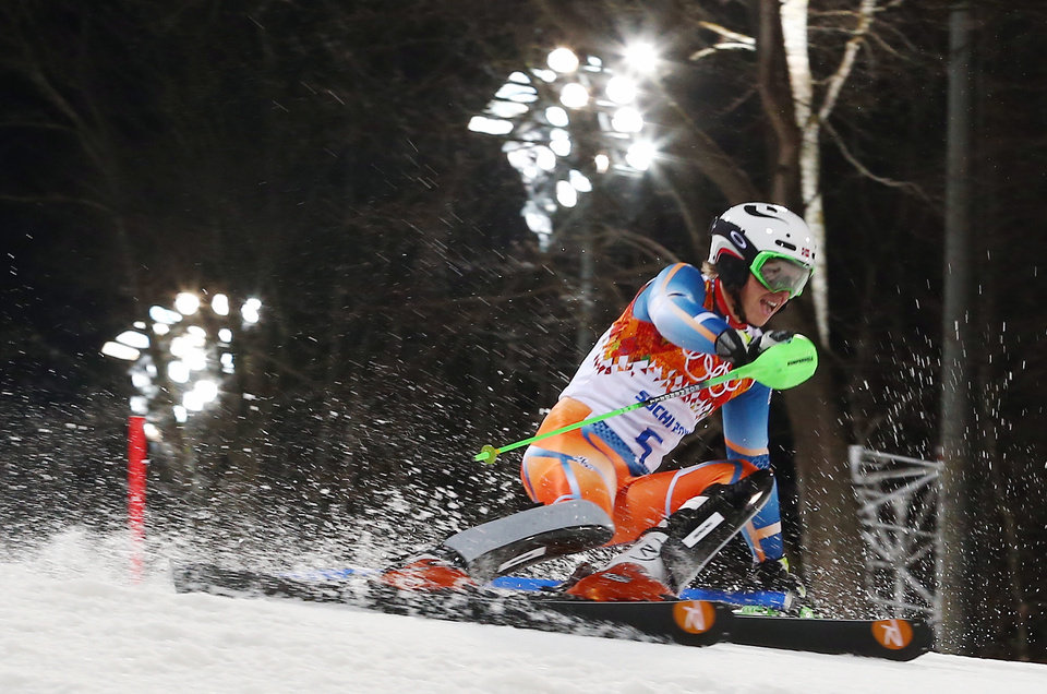 Photo - Norway's Henrik Kristoffersen skis past a gate in the second run of the men's slalom to win the bronze medal at the Sochi 2014 Winter Olympics, Saturday, Feb. 22, 2014, in Krasnaya Polyana, Russia. (AP Photo/Alessandro Trovati)