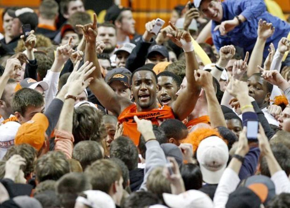 Photo - Oklahoma State's Brian Williams celebrates with fans following an NCAA college basketball game between the Oklahoma State University Cowboys (OSU) and the Missouri Tigers (MU) at Gallagher-Iba Arena in Stillwater, Okla., Wednesday, Jan. 25, 2012. Oklahoma State won 79-72. Photo by Bryan Terry, The Oklahoman