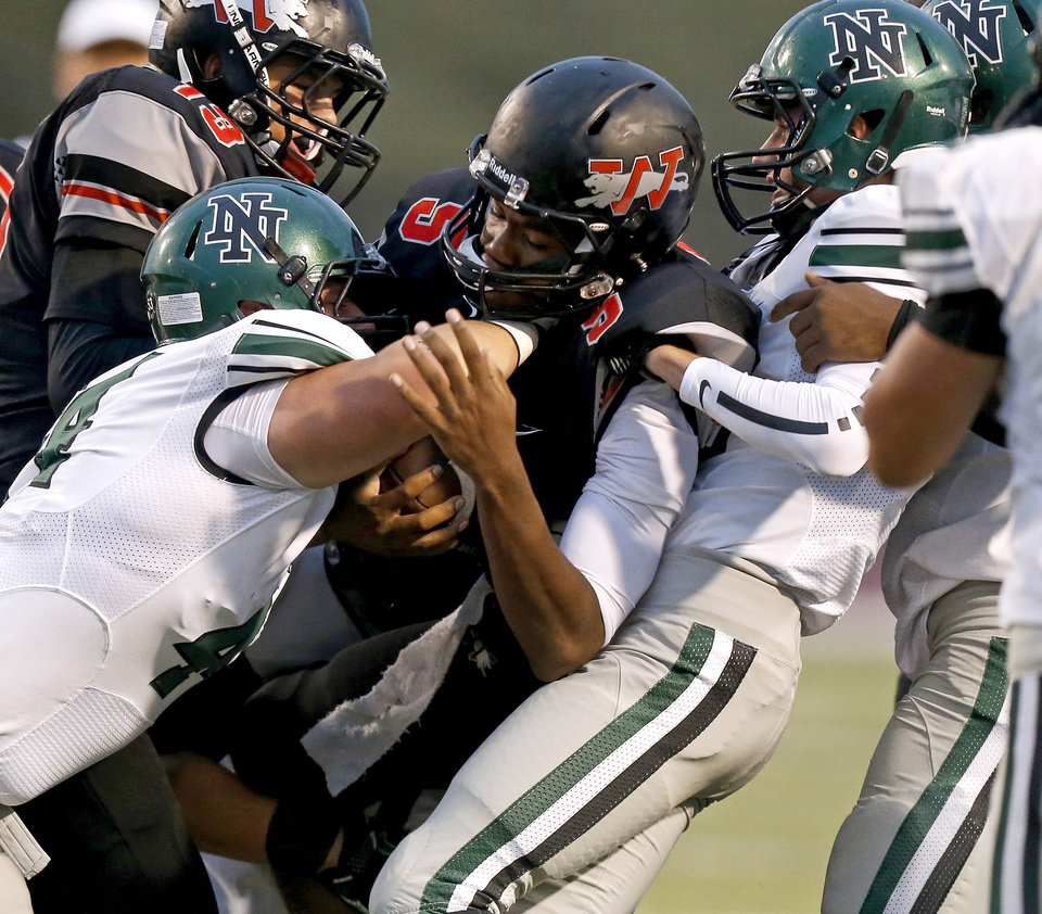 Norman North's Jaxon Uhles, left, and Carter Klein bring down Westmoore's Jhames West during a high school football game in Moore, Okla., Thursday, September 13, 2012. Photo by Bryan Terry, The Oklahoman