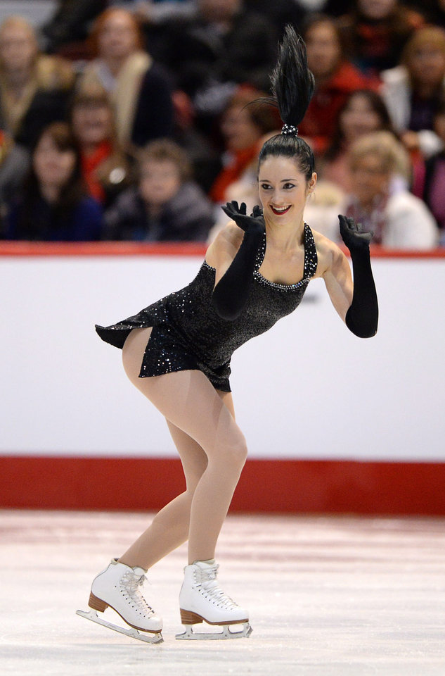 Photo - Kaetlyn Osmond competes during the women's short program at the Canadian Figure Skating Championship in Ottawa, Ontario, on Friday, Jan. 10, 2014. (AP Photo/The Canadian Press, Sean Kilpatrick)