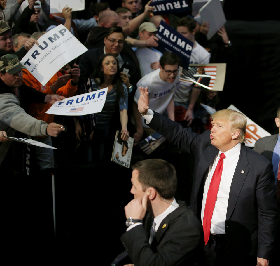 Photo - Republican presidential candidate Donald Trump waves to supporters after a rally at the Cox Convention Center in Oklahoma City, Friday, Feb. 26, 2016. Photo by Bryan Terry, The Oklahoman