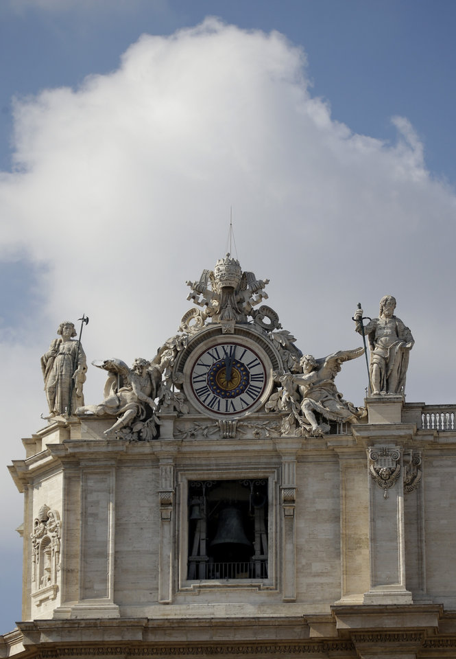"One of the clocks topping St. Peter's Basilica's facade marks noon, the time at which the popes celebrate the Angelus prayer in St. Peter's Square, at the Vatican, Sunday, March 3, 2013. Benedict XVI's 8 p.m. resignation Thursday, Feb. 28, opened what is known as the ""sede vacante'' or ""vacant see'' _ the transition period between papacies when a few key Vatican officials take charge of running the church.(AP Photo/Andrew Medichini)"