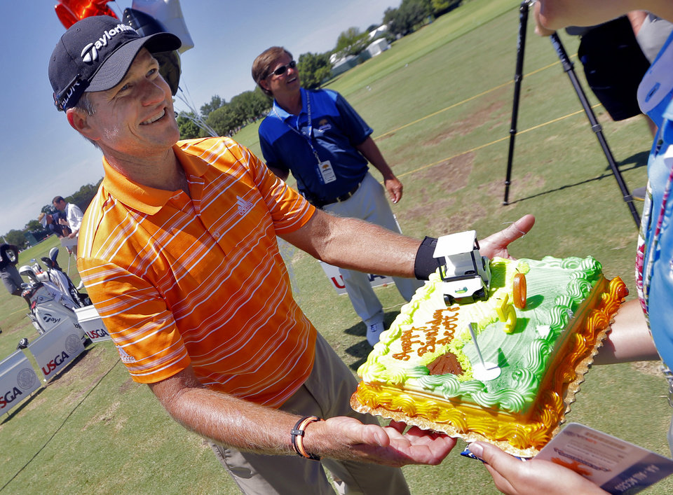 Photo - Scott Verplank is presented a 50th birthday cake by the USGA during practice rounds for the U.S. Senior Open golf tournament at Oak Tree National in Edmond, Okla. on Wednesday, July 9, 2014. Photo by Chris Landsberger, The Oklahoman