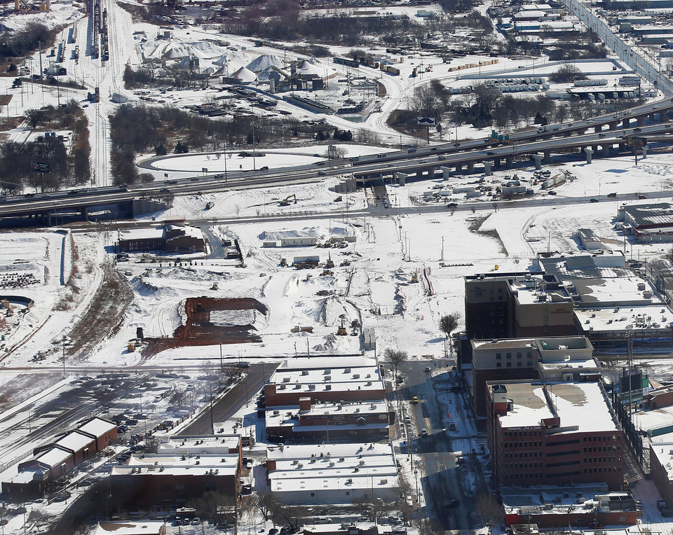 Photo - Both sides of Sheridan Avenue, snow-covered Thursday, have been cleared of the old Stewart Metal Fabricators complex and are set to be redeveloped into housing, hotels, retail, restaurants and a concert venue.  Photo by Jim Beckel, The Oklahoman  Jim Beckel