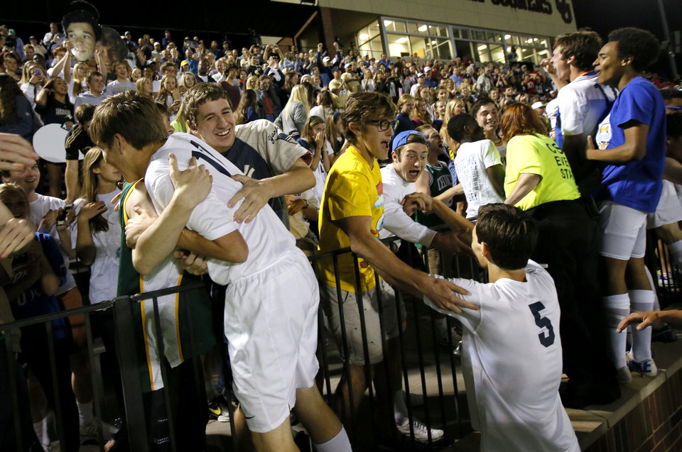 Photo - Heritage Hall players celebrate with fans after their win in the Class 5A boys soccer championship between Heritage Hall and Skiatook in Norman, Okla., Friday, May 16, 2014. Photo by Bryan Terry, The Oklahoman