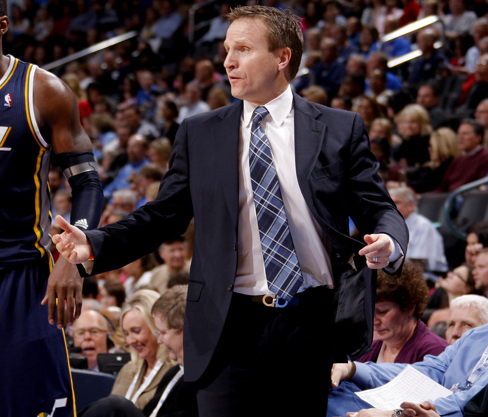 Photo - Oklahoma CIty coach Scott Brooks talks with an official during an NBA game between the Oklahoma City Thunder and the Utah Jazz at Chesapeake Energy Arena in Oklahoma CIty, Tuesday, Feb. 14, 2012. Photo by Bryan Terry, The Oklahoman