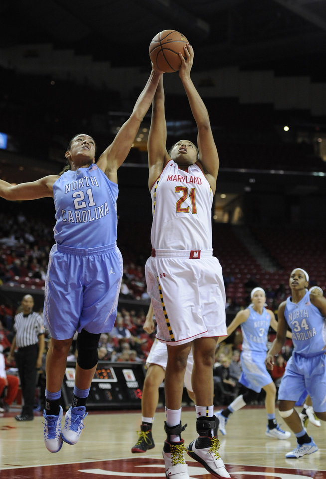 Maryland's Tianna Hawkins (21), foreground right, and North Carolina's Krista Gross reach for a rebound during the first half of an NCAA college basketball game on Thursday, Jan. 24, 2013, in College Park, Md. (AP Photo/Gail Burton).