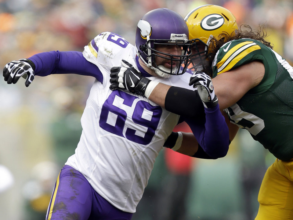 Photo - FILE - In this Nov. 24, 2013, file photo, Minnesota Vikings Jared Allen rushes during an NFL football during the game against the Green Bay Packers at the Lambeau Field in Green Bay Wis. The Chicago Bears replaced one accomplished veteran pass rusher with another Wednesday, March 26, 2014, when they agreed to terms with Allen on a four-year contract. A person with knowledge of the agreement told The Associated Press that Allen will get $15.5 million guaranteed on a deal that could be worth as much as $32 million. The person requested anonymity because the terms have not been announced. (AP Photo/Mike McGinnis, File)