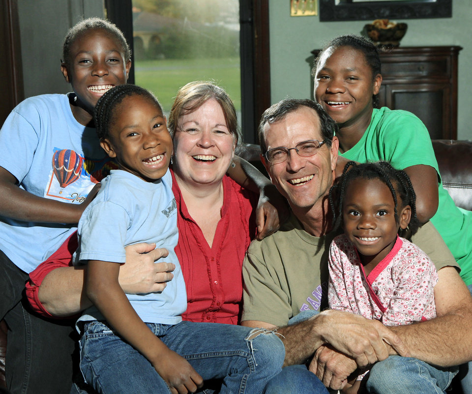Penny and Ardee Tyler pose for a portrait with their four adopted Liberian-born daughter minutes before Ardee received a phone call informing him that the  sisters would be taken from their custody by a DHS case worker late Friday, April 9, 2010. From left are Nahawa11, Bindu, 8, Penny and Ardee, Mary, 16, in back and Fatu, 5. The family was in the Shawnee home of an Oklahoman reporter for an interview when this photo was taken. Photo by Jim Beckel, The Oklahoman
