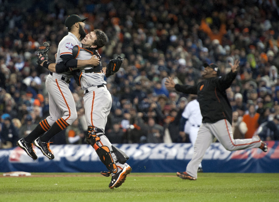 Photo -   San Francisco Giant's catcher Buster Posey and pitcher Sergio Romo celebrate defeating the Detroit Tigers in Game 4 of baseball's World Series on Sunday, Oct. 28, 2012, in Detroit. The Giants won the World Series 4-0. (AP Photo/The Sacramento Bee, Paul Kitagaki Jr.) MAGS OUT; LOCAL TV OUT (KCRA3, KXTV10, KOVR13, KUVS19, KMAZ31, KTXL40); MANDATORY CREDIT