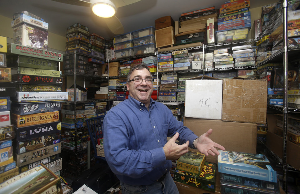 Photo - In this Thursday, Jan. 9, 2014,  photo, Spirit Airlines CEO Ben Baldanza shows his collection of board games at his home, in Fort Lauderdale, Fla. (AP Photo/Alan Diaz)