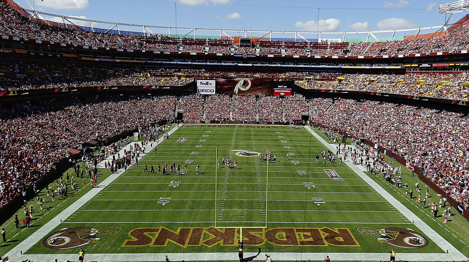 Photo - FILE - In this Sept. 24, 2012, file photo, the Washington Redskins and Cincinnati Bengals face off during the first half of an NFL football game in Landover, Md. The U.S. Patent Office ruled Wednesday, June 18, 2014, that the Washington Redskins nickname is