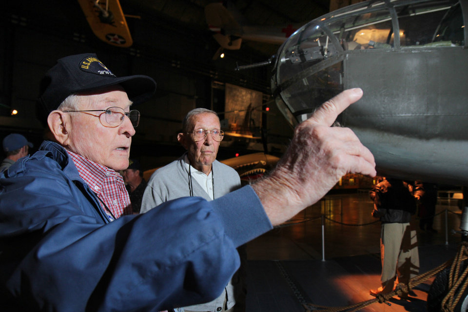 Photo - This Sept. 27, 2013 photo shows former B-25 crewman Robert Crouse and former pilot Paul Young talk about their World War II experiences during a reunion of the 57th Bomb Wing in front of a B-25 bomber in the U.S. Air Force Museum at Wright Patterson Air Force base in Dayton, Ohio. Crouse, of Oak Ridge, Tenn., is 89 years old, but he remembers as if it happened yesterday the time a shell blew out the cockpit windshield (