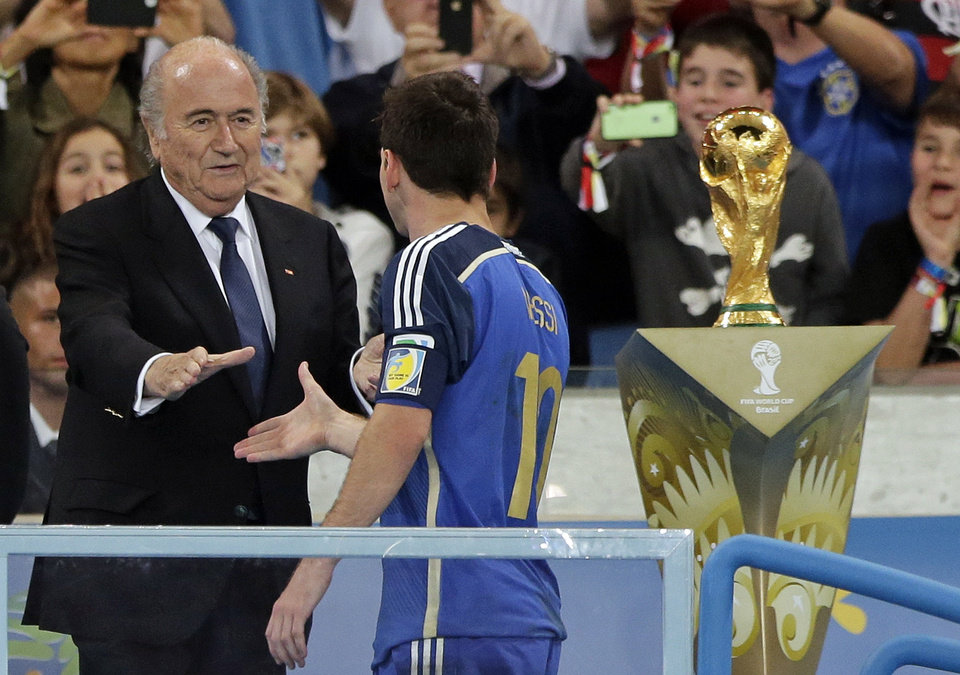 Photo - Argentina's Lionel Messi shakes hands with FIFA President Sepp Blatter after the World Cup final soccer match between Germany and Argentina at the Maracana Stadium in Rio de Janeiro, Brazil, Sunday, July 13, 2014. Germany won the match 1-0. (AP Photo/Matthias Schrader)