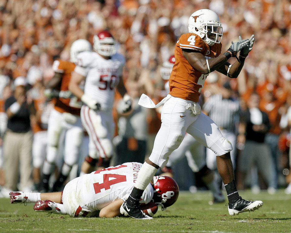 Photo - Aaron Williams of Texas celebrates as Sam Bradford lies on the ground with an injury during the Red River Rivalry college football game between the University of Oklahoma Sooners (OU) and the University of Texas Longhorns (UT) at the Cotton Bowl in Dallas, Texas, Saturday, Oct. 17, 2009. Photo by Bryan Terry, The Oklahoman