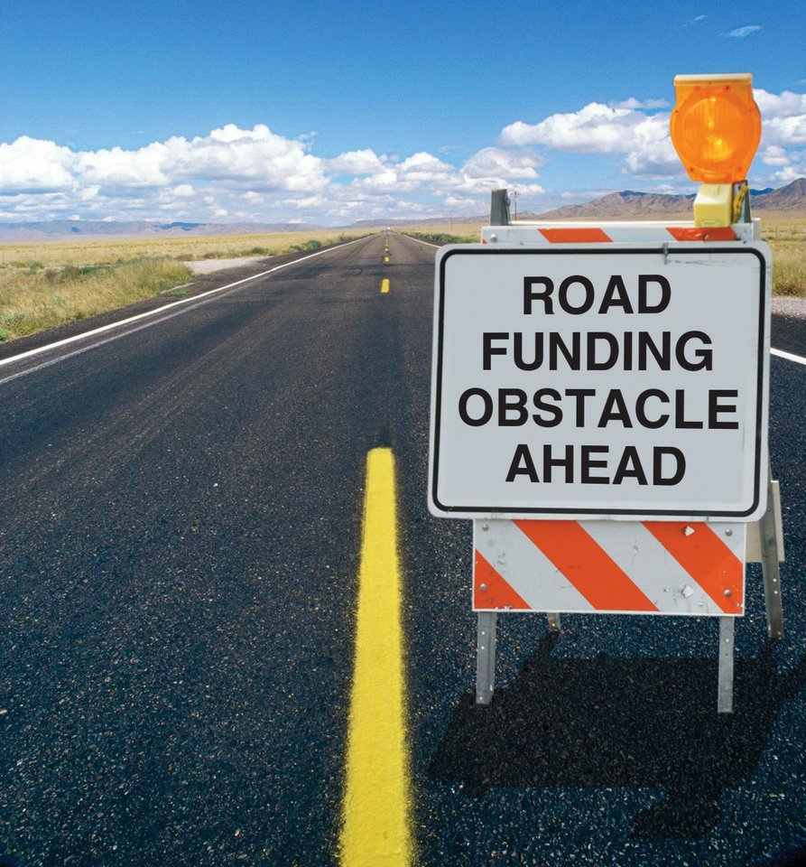 Photo - ROAD FUNDING OBSTACLE AHEAD photo illustration 1) asphalt road 2) road construction sign ILLUSTRATION BY CHRIS SCHOELEN, THE OKLAHOMAN GRAPHICS