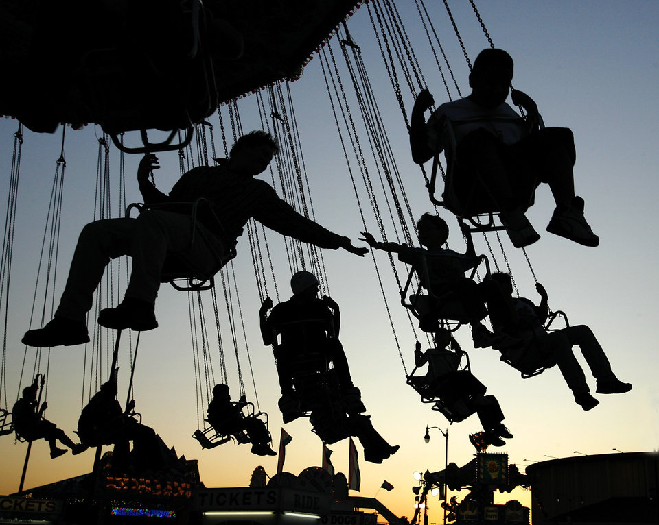 Fairgoers enjoy midway rides at the Oklahoma State Fair  Thursday night, Sept. 24, 2009.   Photo by Jim Beckel, The Oklahoman