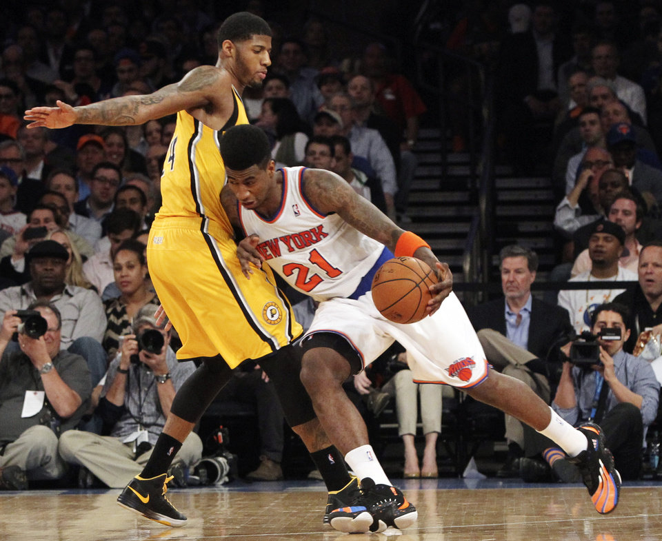Photo - New York Knicks' Iman Shumpert drives past Indiana Pacers' Paul George in the first half of Game 2 of their NBA basketball playoff series in the Eastern Conference semifinals at Madison Square Garden in New York, Tuesday, May 7, 2013. The Knicks won 105-79. (AP Photo/Mary Altaffer)