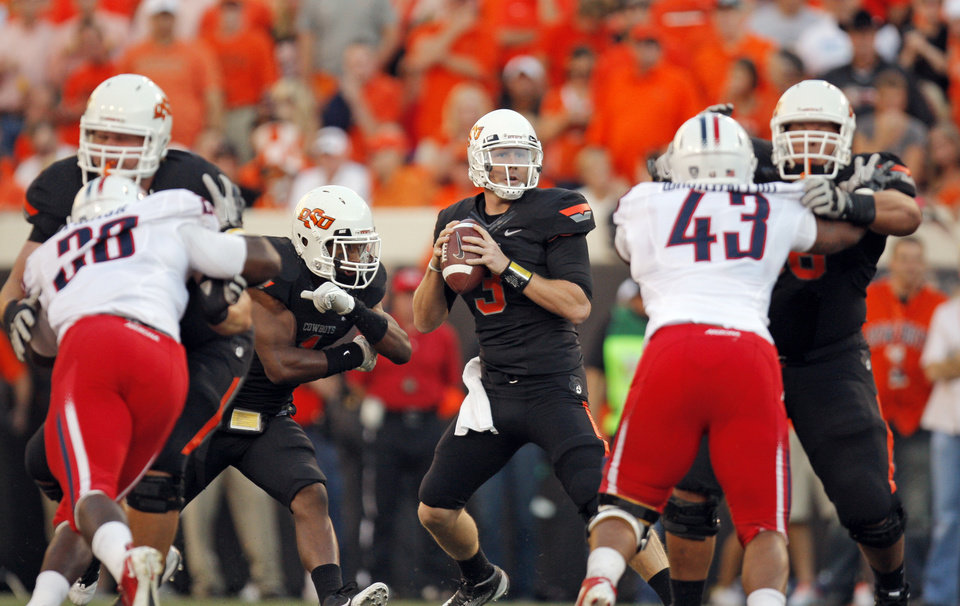 Oklahoma State\'s Brandon Weeden drops back to pass against Arizona on Thursday. Oklahoma State won 37-14. PHOTO BY NATE BILLINGS, The Oklahoman