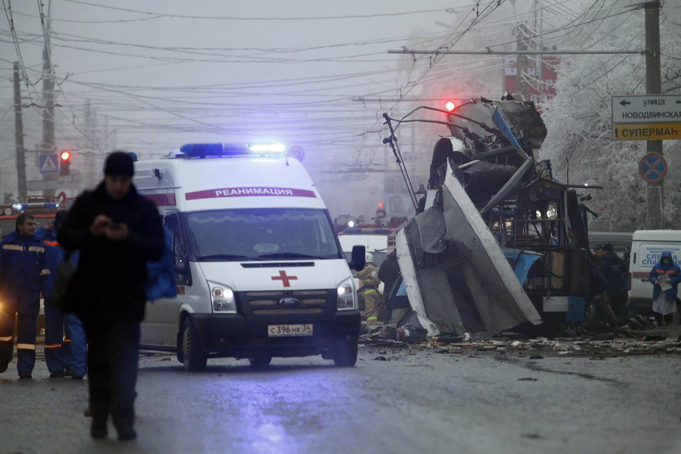 Photo - An ambulance leaves the site of a trolleybus explosion in Volgograd, Russia, Monday, Dec. 30, 2013. The explosion left 10 people dead Monday, a day after a suicide bombing that killed at least 17 at the city's main railway. The explosions put the city on edge and highlighted the terrorist threat that Russia is facing as it prepares to host the Winter Games in February. Volgograd is about 650 kilometers (400 miles) northeast of Sochi, where the Olympics are to be held. (AP Photo/Denis Tyrin)