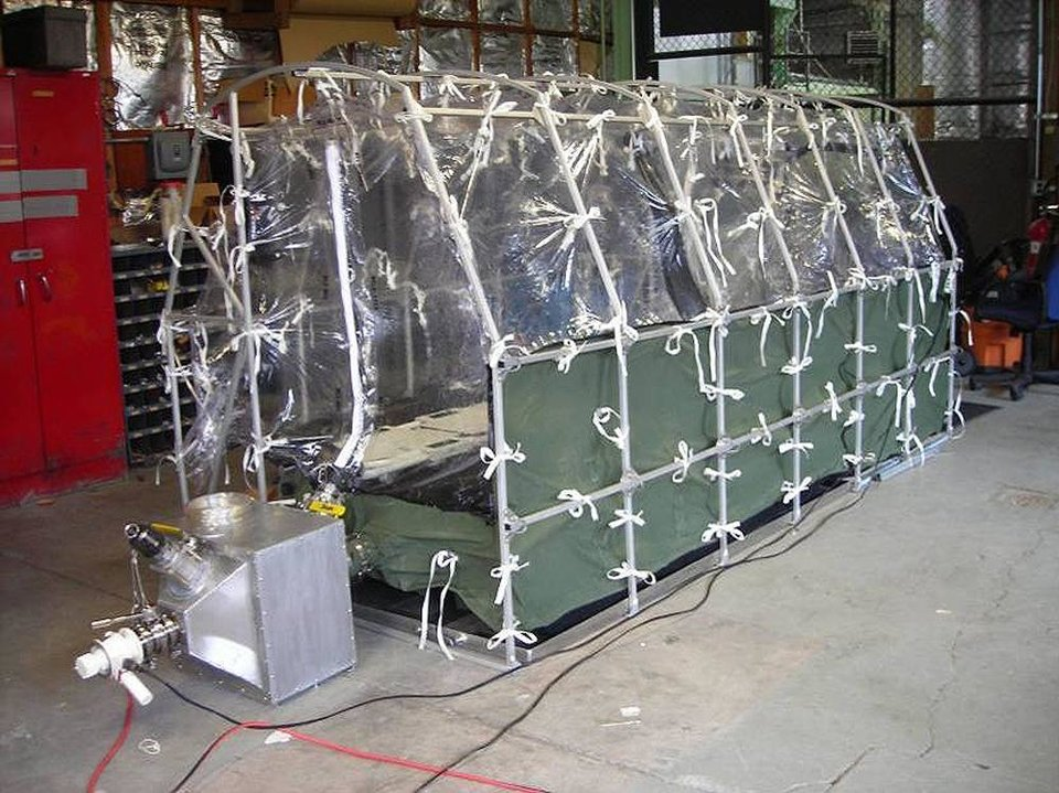 Photo - In this undated photo released by the Center for Disease Control, a Aeromedical Biological Containment System which looks like a sealed isolation tent for Ebola air transportation is shown. On Thursday afternoon July 31, 2014, officials at Atlanta's Emory University Hospital said they expected one of the Americans to be transferred there