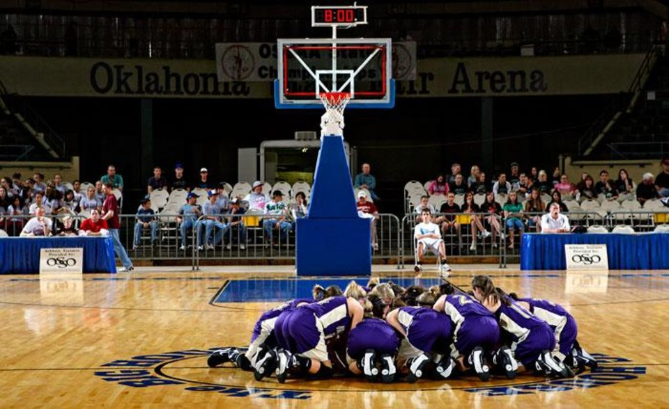 Photo -  The Okarche girls huddle up at center court before the semifinals of the Class A girls Oklahoma State Basketball Championships against Crowder at the State Fair Arena on Friday, March 6, 2009, in Oklahoma City, Okla.  PHOTO BY CHRIS LANDSBERGER, THE OKLAHOMAN
