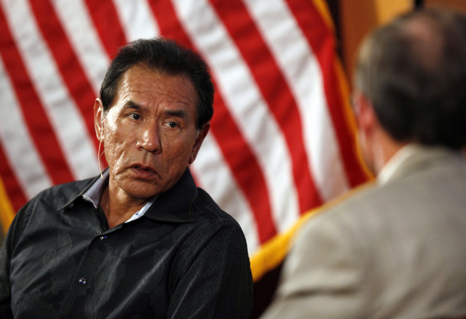 Photo - Actor Wes Studi, left, speaks with Bob L. Blackburn, executive director of the Oklahoma Historical Society, at the Oklahoma History Center in Oklahoma City, Monday, June 11, 2012. Photo by Nate Billings, The Oklahoman