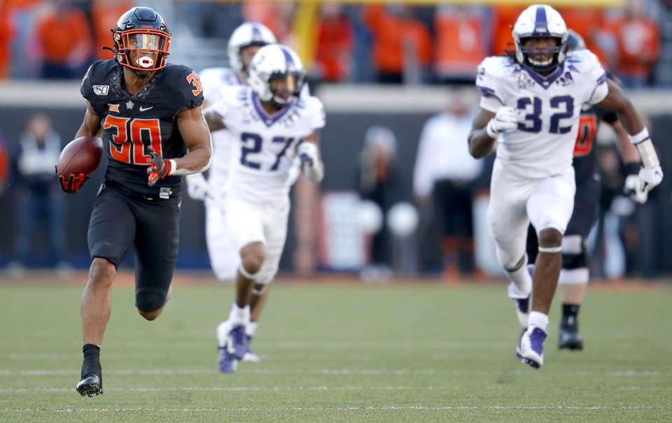 Photo - Oklahoma State's Chuba Hubbard (30) rushes for a 62-yard touchdown in the fourth quarter during the college football game between the Oklahoma State University Cowboys and the TCU Horned Frogs at Boone Pickens Stadium in Stillwater, Okla.,  Saturday, Nov. 2, 2019. [Sarah Phipps/The Oklahoman]