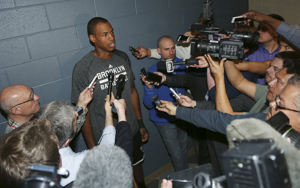 Photo - Brooklyn Nets center Jason Collins talks to reporters before the Nets faced the Denver Nuggets in an NBA basketball game in Denver on Thursday, Feb. 27, 2014. (AP Photo/David Zalubowski)